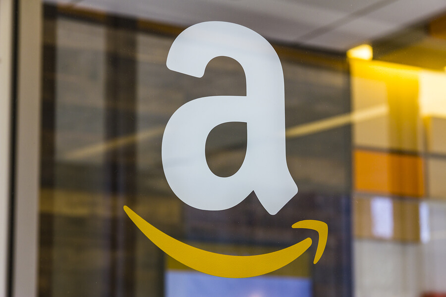 Picture of amazon logo on store door.