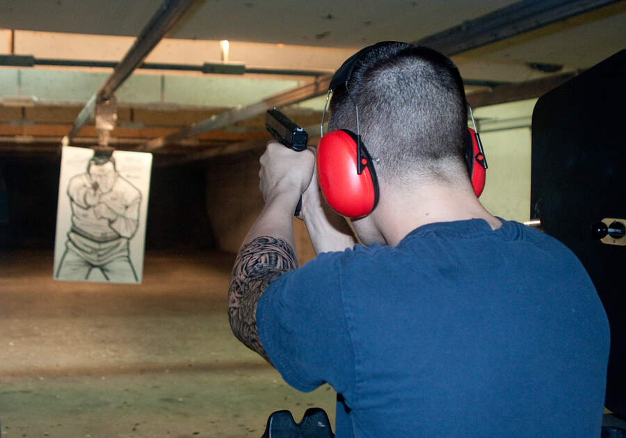 Picture of a felon at a shooting range.