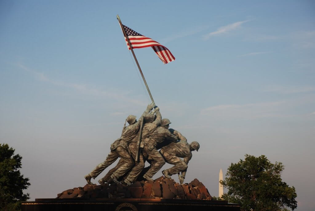 Image of Marines raising an American Flag