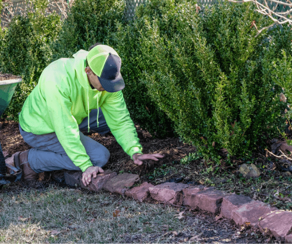 Image of someone working on landscaping.
